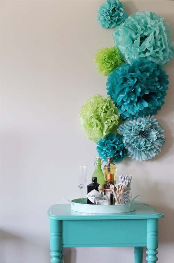 diy paper pom backdrop by the sweetest occasion via Easy DIY Wedding Ideas