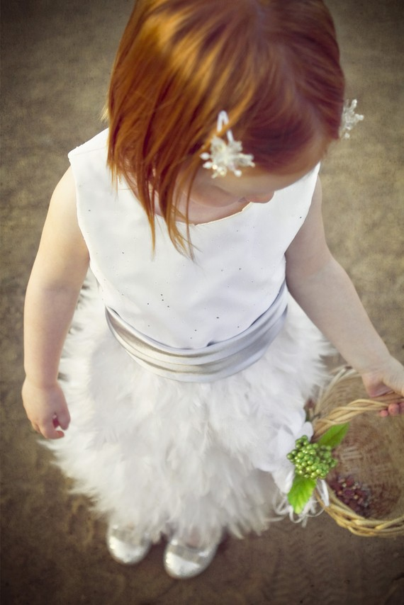 Feather Themed Wedding - feather flower girl dress by beane and co