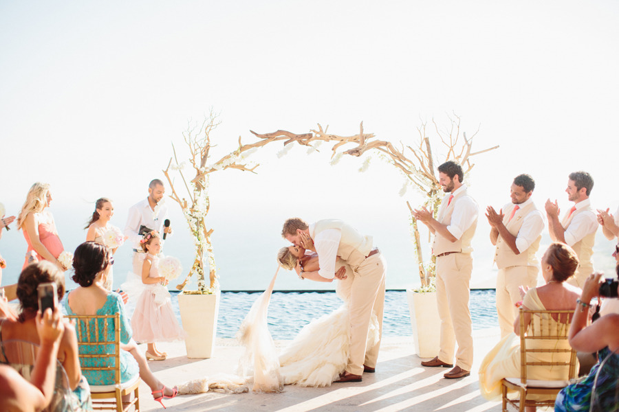 get married under a driftwood arch | photo: sara & rocky | via emmalinebride.com