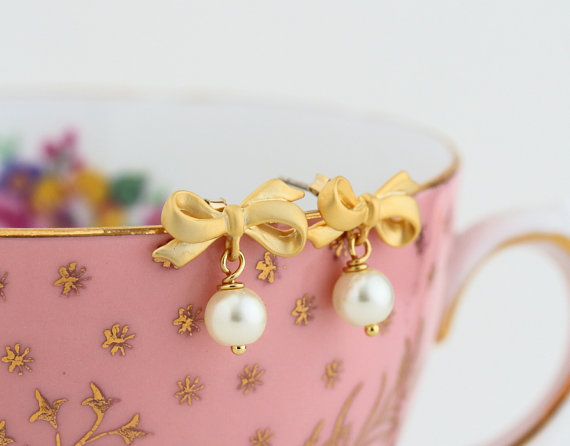 gold ivory pearl earrings with bow