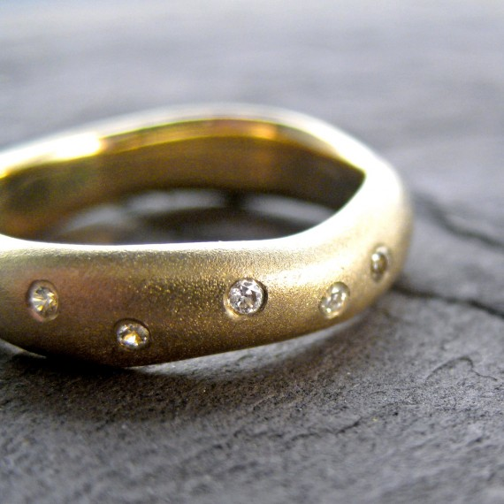 gold wedding ring with tiny round diamonds | handmade wedding bands | http://emmalinebride.com/jewelry/handmade-wedding-bands/
