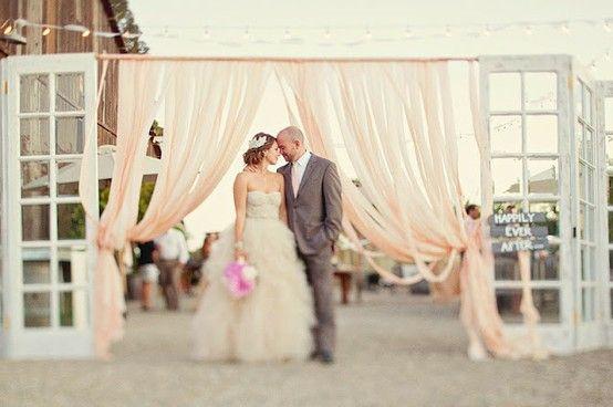 wedding ceremony backdrop with doors | via Ceremony Backdrops Doors | photo: Ellie Grover