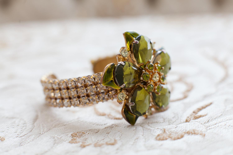 green rhinestone cuff bracelet by cloe noel, photo by la candella weddings