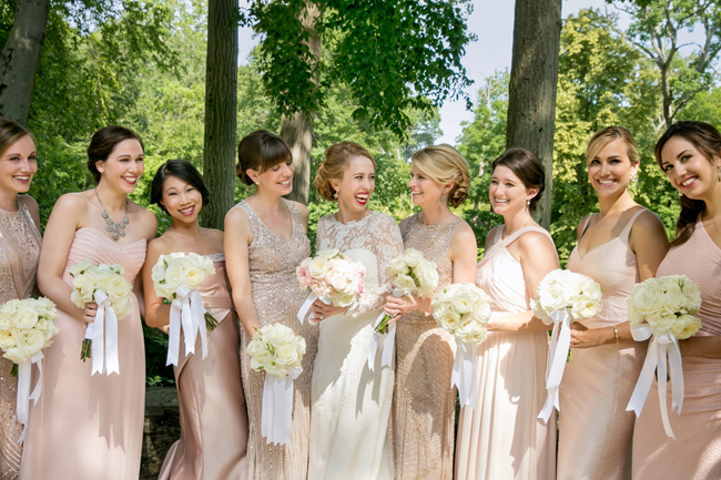bride and bridesmaids laughing at Connecticut waterfront wedding - photo: Melani Lust Photography | via https://emmalinebride.com