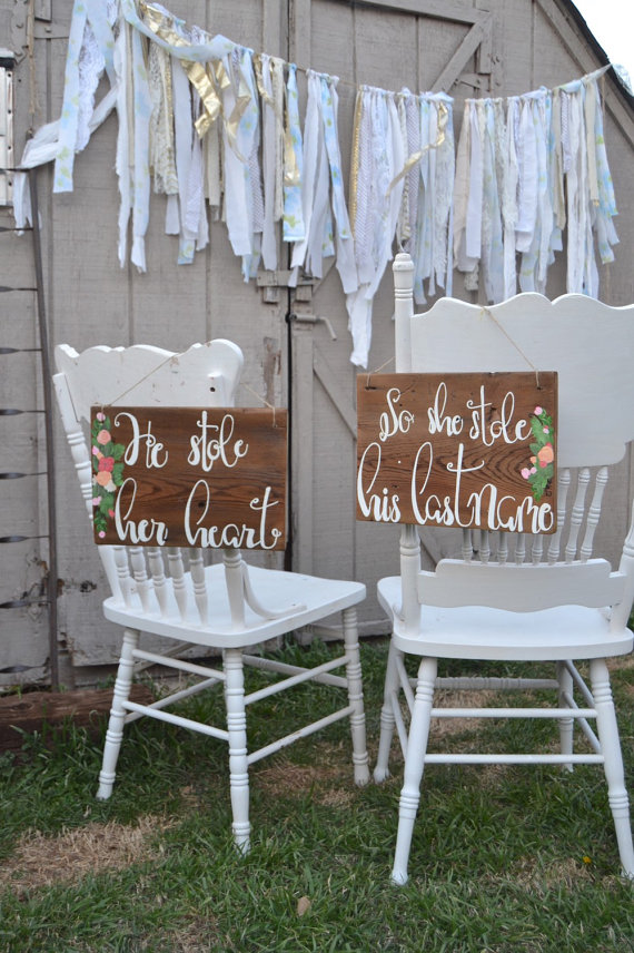 he stole her heart chair signs | via bride and groom chair signs https://emmalinebride.com/decor/bride-and-groom-chairs/