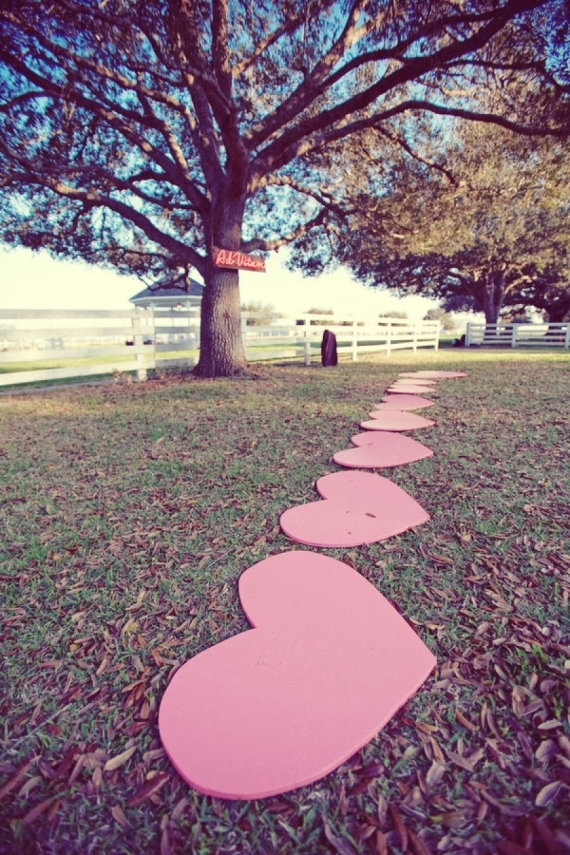 The bride and groom, Jessica and Steven, made their own heart shaped stepping stones for bridesmaids to stand on so their heels wouldn't dig into the grass.