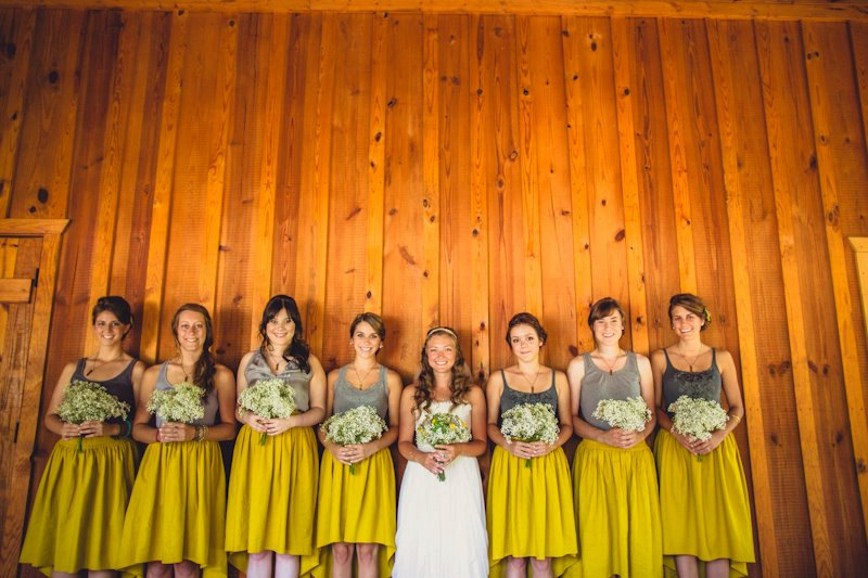 These bridesmaid skirts feature a hi low hem and are available in a variety of colors.  These mustard yellow ones are my favorite! | https://emmalinebride.com/bridesmaids/bridesmaid-skirts-hi-low-hem/