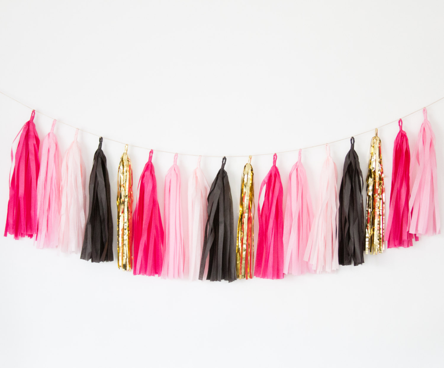 hot pink and black tassel garland by blush bazaar | fun bachelorette party ideas | http://emmalinebride.com/planning/fun-bachelorette-party-ideas/