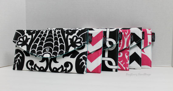 Hot Pink and Black Mismatched Clutches - pick a purse each bridesmaid will love in a particular color with her own unique pattern or print.