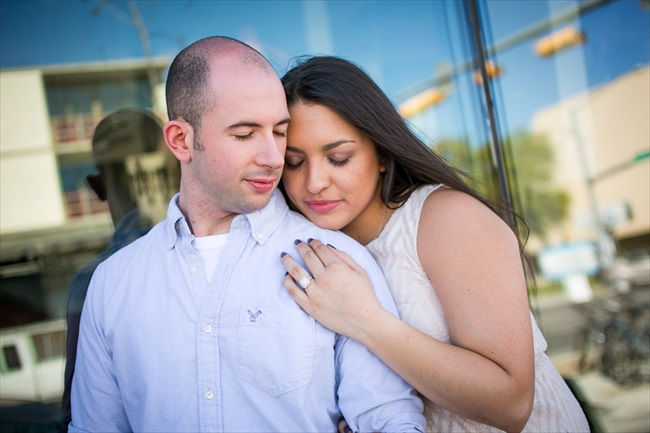engaged couple showing off ring at their Fun Austin Engagement Session | Photographer: Adrianne Riley Photography | via https://emmalinebride.com/real-weddings/fun-austin-engagement-session-priscella-jerry/