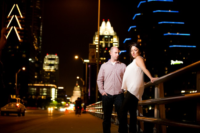 couple on bridge with the city skyline at their Fun Austin Engagement Session | Photographer: Adrianne Riley Photography | via https://emmalinebride.com/real-weddings/fun-austin-engagement-session-priscella-jerry/