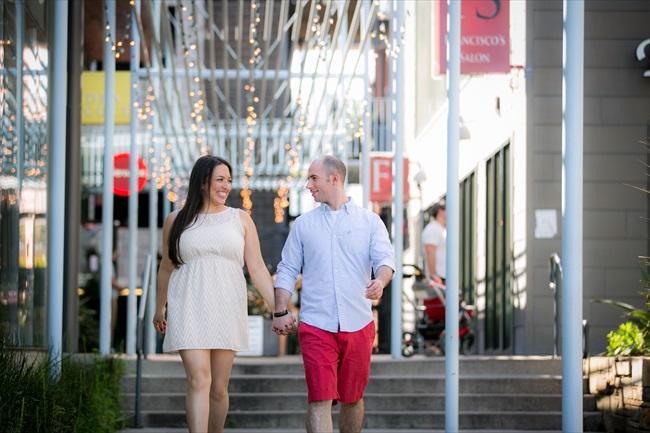 couple walks in downtown at their Fun Austin Engagement Session | Photographer: Adrianne Riley Photography | via https://emmalinebride.com/real-weddings/fun-austin-engagement-session-priscella-jerry/