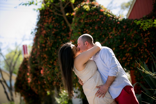 engaged couple kisses at their Fun Austin Engagement Session | Photographer: Adrianne Riley Photography | via https://emmalinebride.com/real-weddings/fun-austin-engagement-session-priscella-jerry/