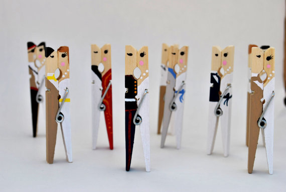 7 Unique Table Number Holders - kissing clothespins by pinned together