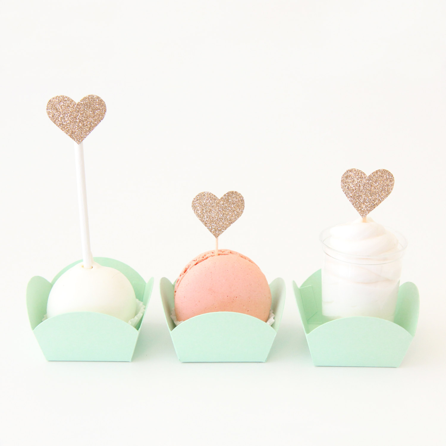 macarons in mint boxes | via 7 Things to Know About Giving Macaron Favors https://emmalinebride.com/favors/giving-macaron-favors/