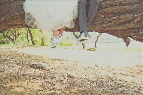 bride and groom show off their Converse wedding kicks at their Maui Beach Wedding
