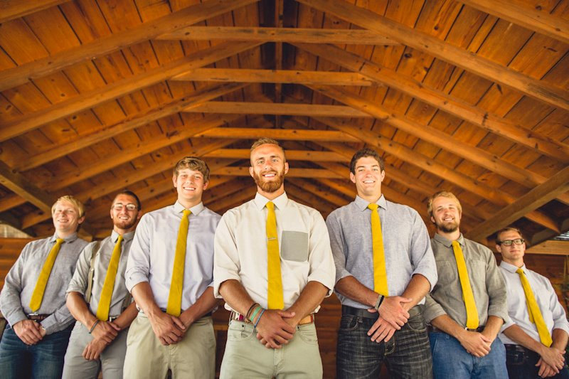These groomsmen ties are perfectly coordinated to the bridesmaids skirts.  Love the mustard yellow color! | https://emmalinebride.com/bridesmaids/bridesmaid-skirts-hi-low-hem/