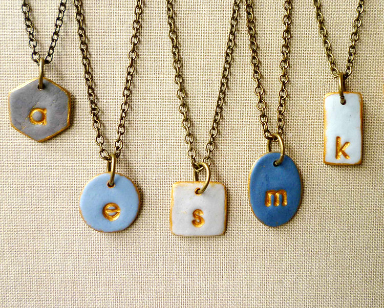 mismatched bridesmaid necklaces in shades of blue | bridesmaid gift ideas http://emmalinebride.com/gifts/bridesmaid-gift-ideas/