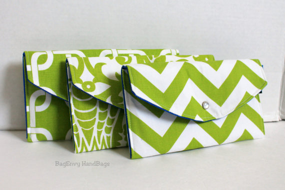 Mismatched Clutches - pick a purse each bridesmaid will love in a particular color with her own unique pattern or print.