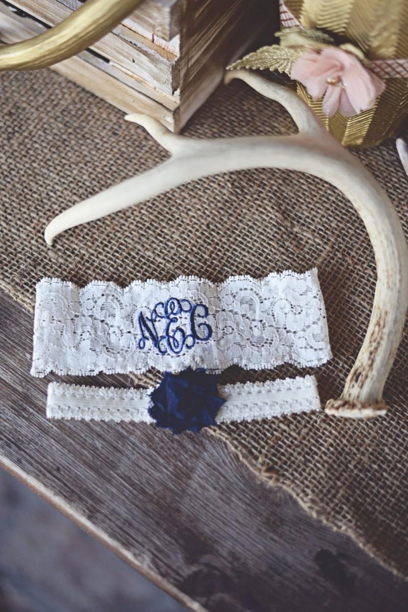 monogrammed garter | via https://emmalinebride.com/decor/navy-and-white-wedding-ideas/ | from 21 Navy and White Wedding Ideas
