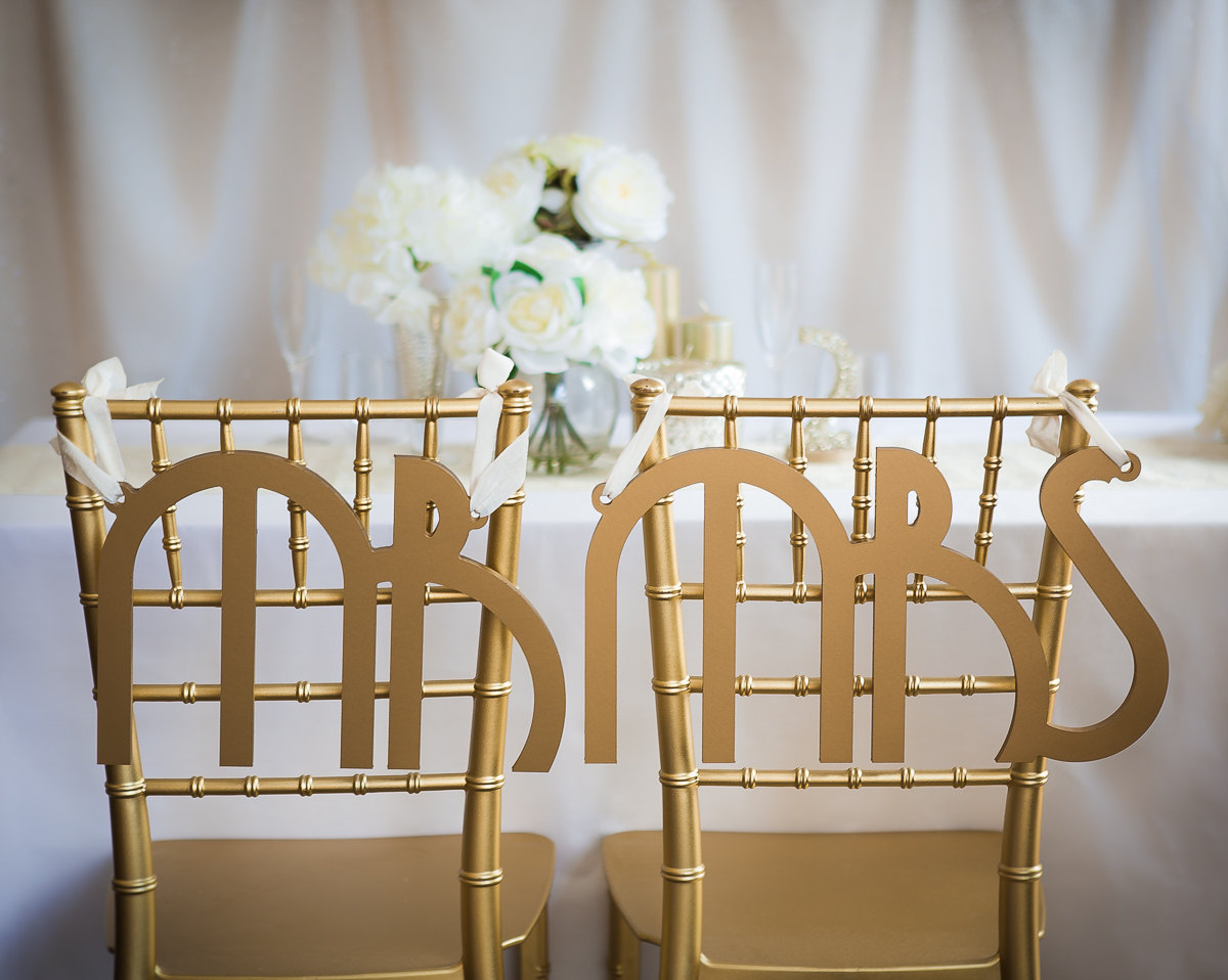 mr mrs gatsby chair signs | via bride and groom chair signs https://emmalinebride.com/decor/bride-and-groom-chairs/