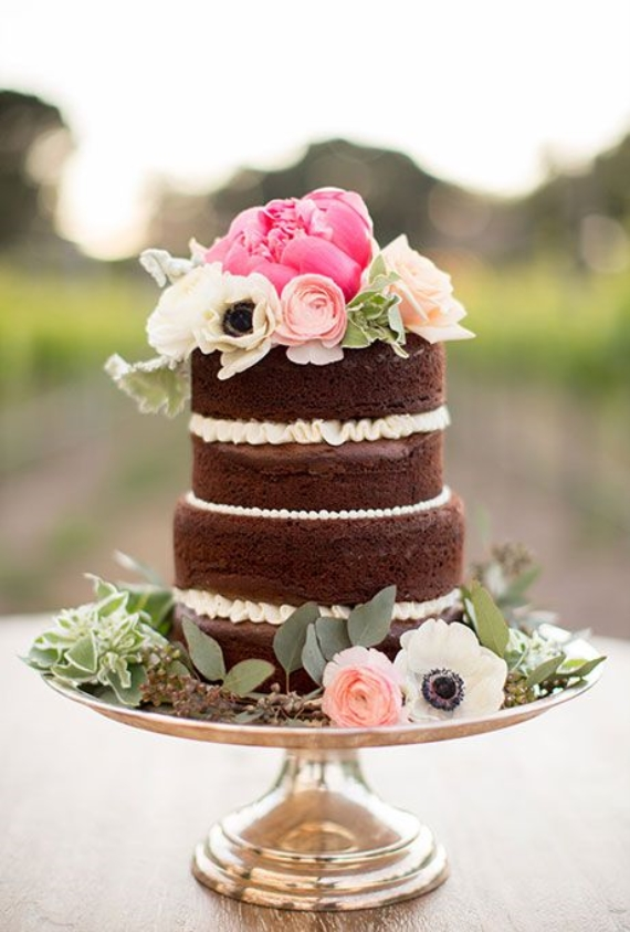 Naked Wedding Cake with Flowers on Top via 30 Wedding Cakes - cake: deux bakery, photo: anna j photography