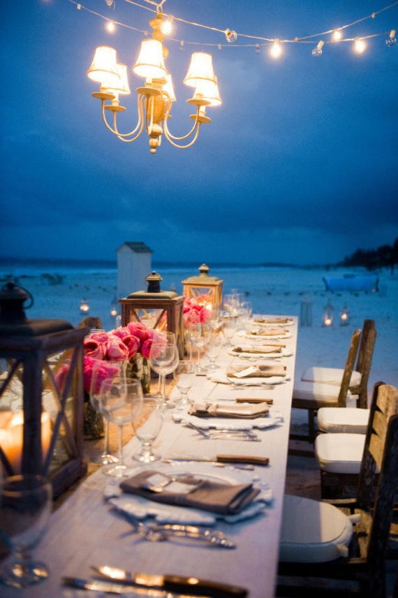 night wedding ideas: chandelier and lanterns on tables