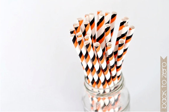 orange and black striped straws via 30 Amazing Halloween Wedding Ideas from EmmalineBride.com