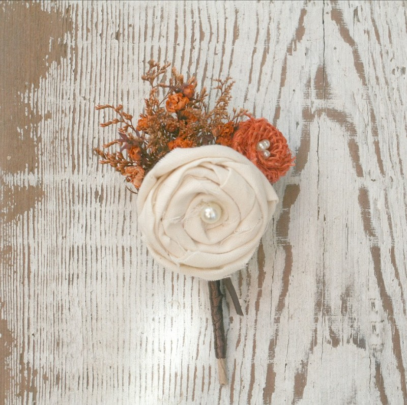 orange wildflower and ivory rosette boutonniere by The Sunny Bee | boutonnieres fall weddings