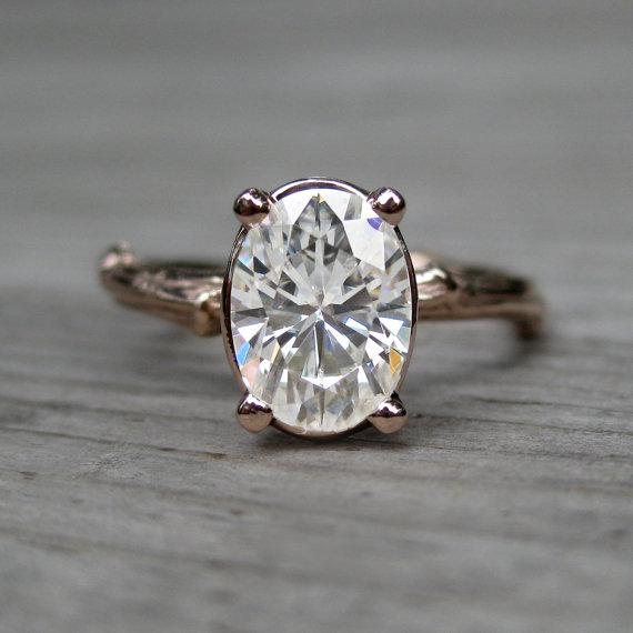 oval moissanite engagement ring (via 7 Alternative Engagement Ring Ideas)