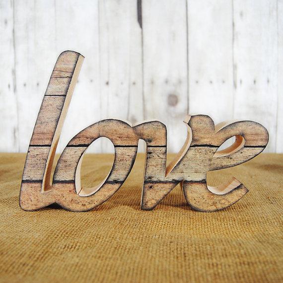 paint your own love decor | Best DIY Wedding Projects via http://emmalinebride.com/decor/best-wedding-diy-projects/