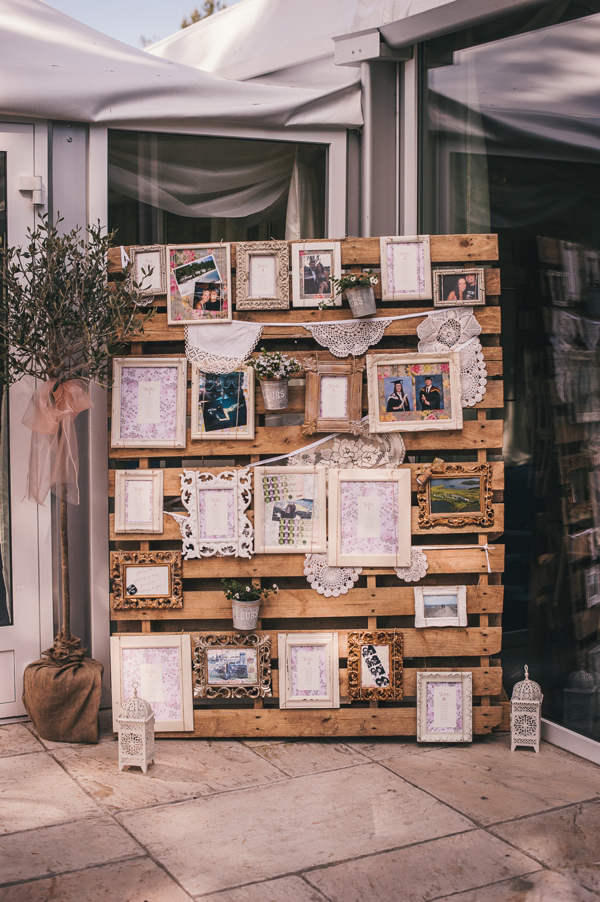pallet decorated with vintage photo frames