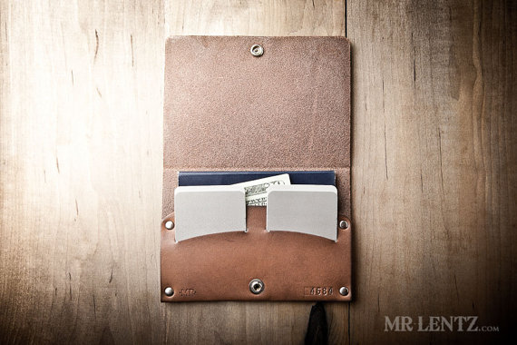 passport wallet | 50 Most Unique Groomsmen Gifts | via http://emmalinebride.com/groom/unique-groomsmen-gifts-2015/