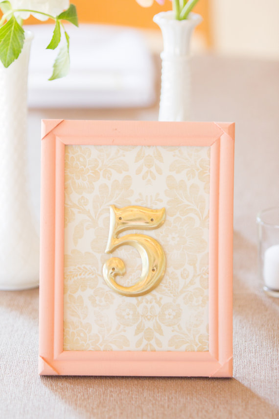 Gold Table Numbers with Peach Frame (by River Kiss Weddings via Emmaline Bride)