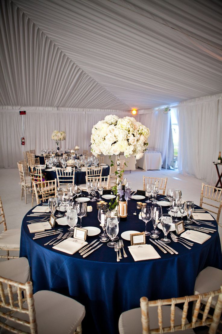 reception decor - photo: true photography weddings | via https://emmalinebride.com/decor/navy-and-white-wedding-ideas/ | from 21 Navy and White Wedding Ideas