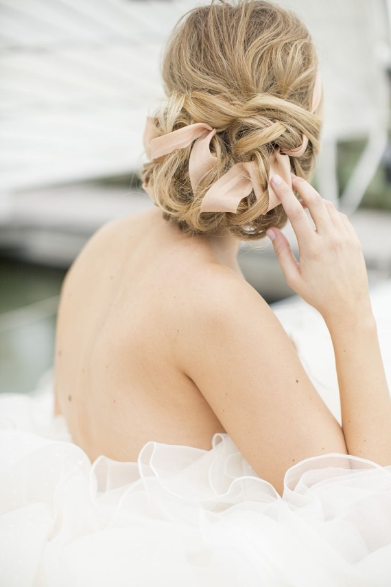 ribbon in bride's hair wedding hairstyle