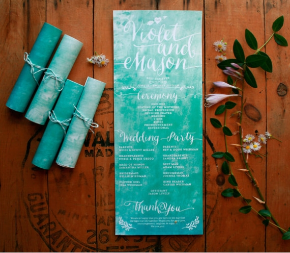 rolled up wedding program with blue watercolor design