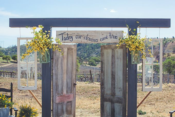 rustic wedding ceremony with doors and today our lives become one sign | Ceremony Backdrops Doors | photo: Lindsey Gomes