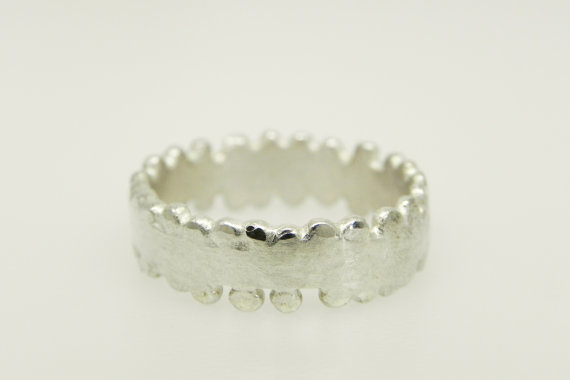 smith granulated wedding ring via 7 Alternative Wedding Ring Ideas