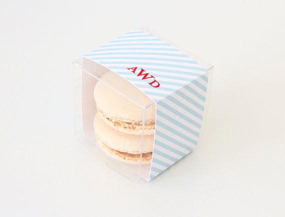 blue and write striped monogram favor box for macarons | via http://emmalinebride.com/favors/giving-macaron-favors/