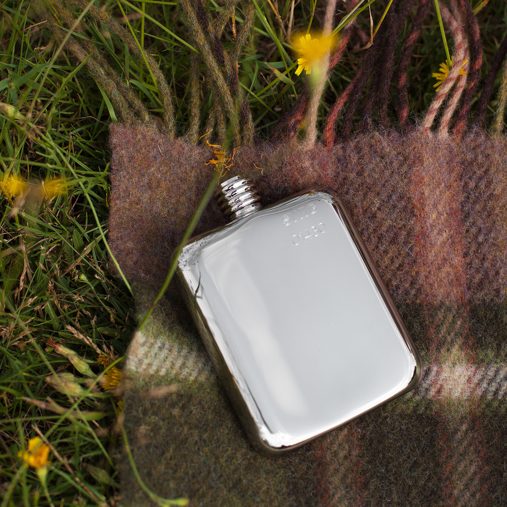 swig flask on plaid blanket | groomsmen flasks | https://emmalinebride.com/groomsmen/groomsmen-flasks-swig/