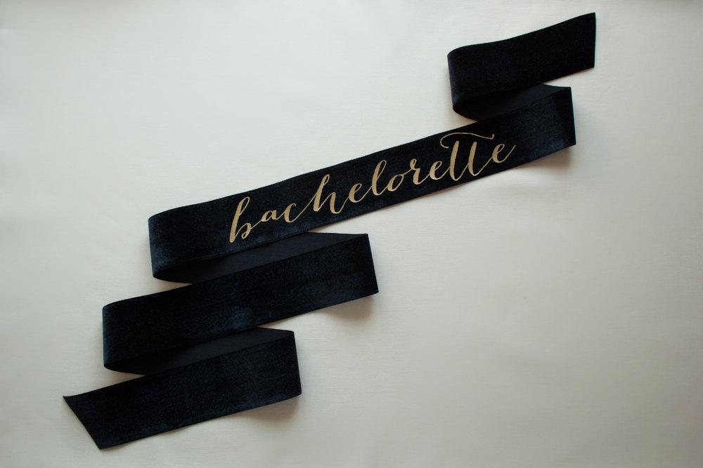 velvet bachelorette sash | stylish bachelorette sash ideas | via https://emmalinebride.com/bride/bachelorette-sash-ideas/