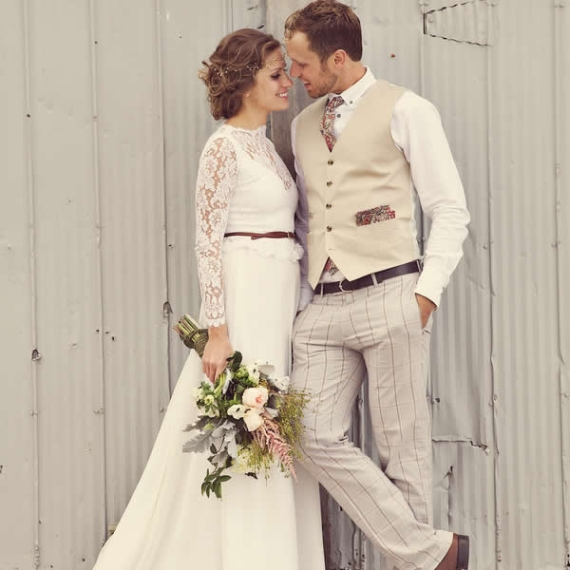 vest and dress pants groom attire for barn wedding