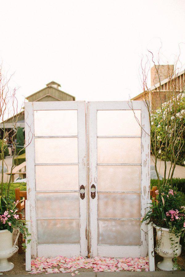 vintage wedding backdrop with doors | Ceremony Backdrops Doors | photo: Stacey Ramsey
