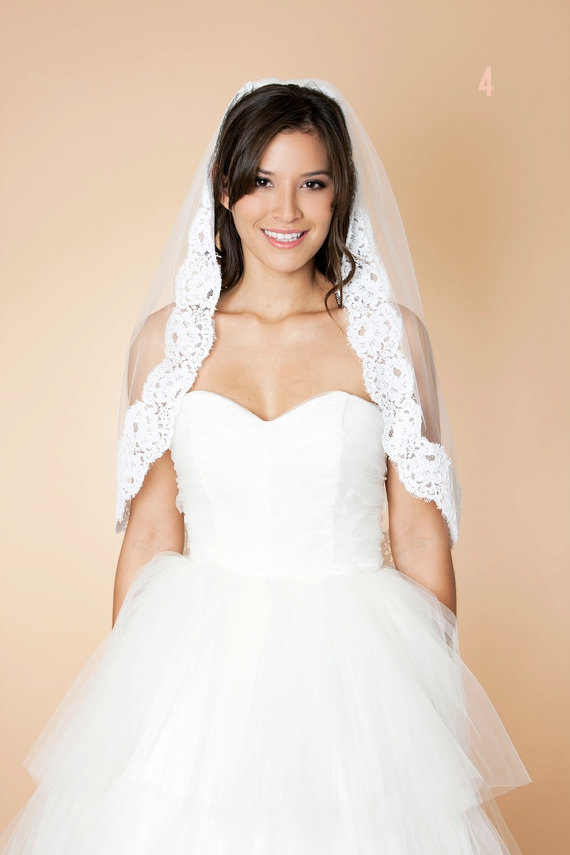 Wedding Veil Styles: The Ultimate Guide (Part One) - waist length veil by marisol aparicio, photo by mira adwell