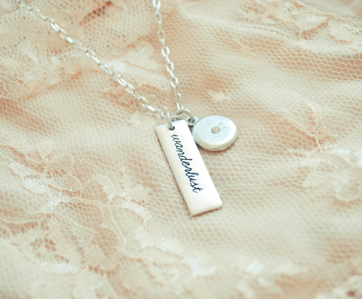 wanderlust necklace with heart | gifts bridesmaids travel | https://emmalinebride.com/gifts/gifts-bridesmaids-travel