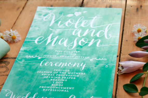 rolled up wedding program in blue watercolor design