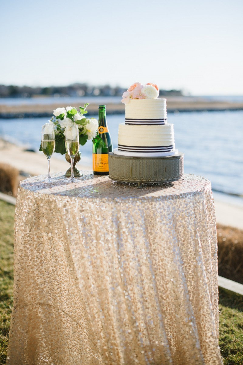 wedding cake with navy blue and white striped ribbon, photo: natalie franke | via https://emmalinebride.com/decor/navy-and-white-wedding-ideas/ | from 21 Navy and White Wedding Ideas