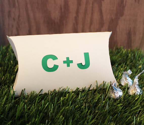 Include your wedding initials in unexpected places at your wedding, such as your favor boxes.