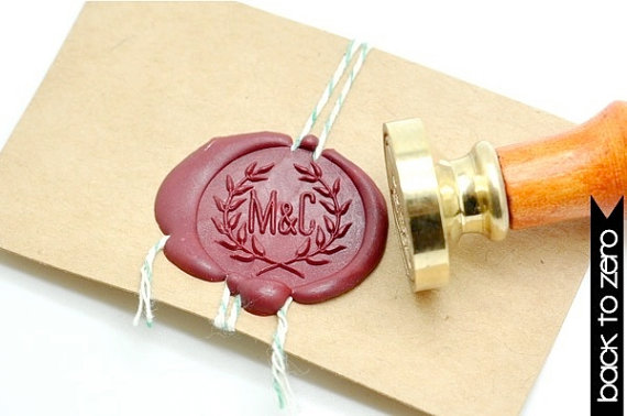 Personalize your invitations with your wedding initials, sealed on the back with wax.